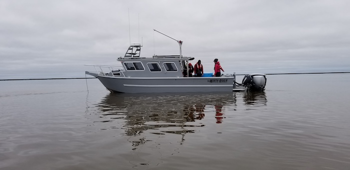 Figure 6. UTEP's Aliuq research vessel and PI's and students from UTEP and UTMSI conducting research in Elson Lagoon as part of the BLE-LTER. Photo courtesy of Craig Tweedie.