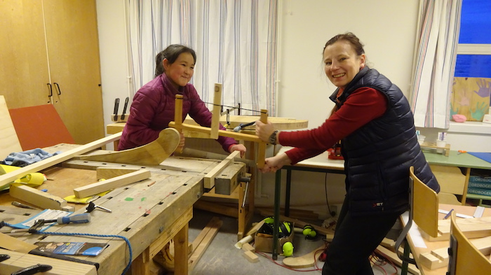 Figure 2. Cutting the wood (Grade 6 pupil Kamilla Korneliussen and teacher Kamilla Oliver). Photo courtesy of Kamilla Oliver.