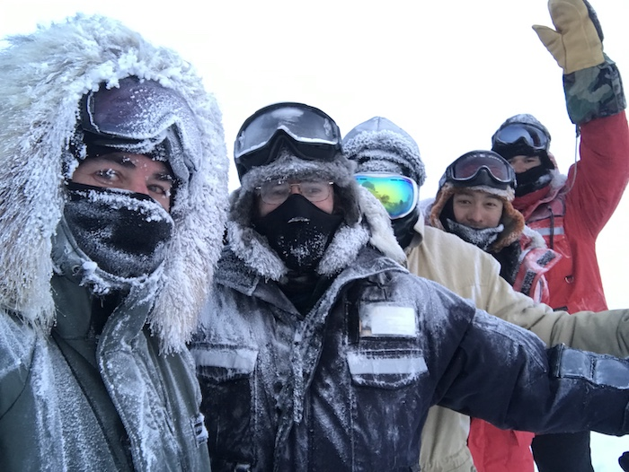 Figure 2. A frosty team of researchers following a long day of winter fieldwork on the North Slope of Alaska. Photo courtesy of Benjamin M. Jones.