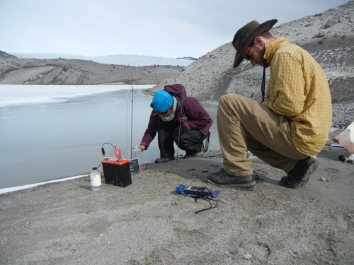 Figure 1. Ben Linhoff (right) and Jemma Wadham collecting groundwater samples for later chemical analysis at the terminus of the Leverett Glacier. Photo courtesy of Matt Charette, WHOI.