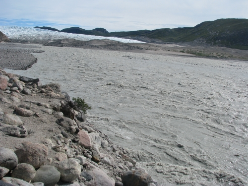 Figure 2. Late season meltwater discharge from the Leverett Glacier. The river's brown color comes from a high load of suspended sediments. Photo courtesy of Ben Linhoff.