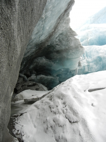 Figure 3. Early season (May) view inside the meltwater portal at the terminus of the Leverett Glacier prior to the onset of extreme melting later in the summer. The Leverett River originates with meltwater that exits this tunnel. Photo courtesy of Matt Charette, WHOI.