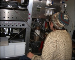 Brooks working with custom-built ice nucleation instrument inside Convair 580. Image courtesy of Sarah Brooks.