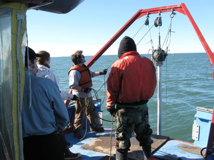 The research team retrieves sediment cores. Image courtesy of Mead Allison, University of Texas.