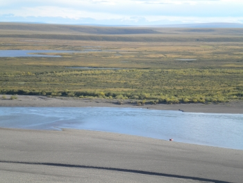 The Colville River drains the Brooks Range across the Arctic Coastal Plain and provides distinct source sediment to lagoons on the coast. Image courtesy of Andrea Jo Miller, University of Texas.