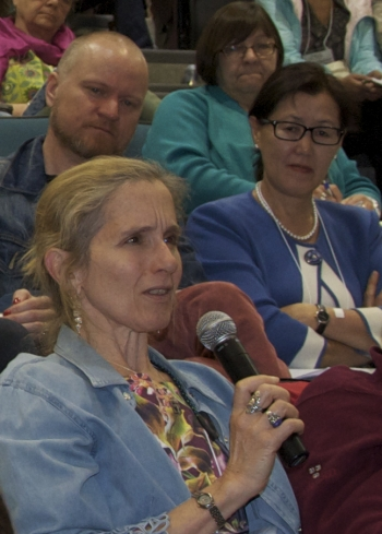 Susan Crate, Professor at George Mason University, poses a question to members of the discussion panel entitled, 'Arctic Futures, Sustainabilities and Strategic Environmental Research.' Photo courtesy of Alona Yefimenko.