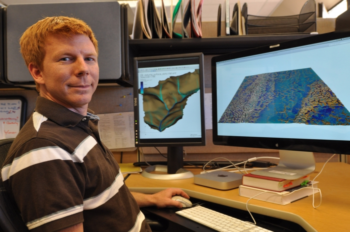 Ethan Coon uses advanced visualization software to understand simulations of snowmelt in Barrow, Alaska. Photo courtesy of Josh Smith, LANL.