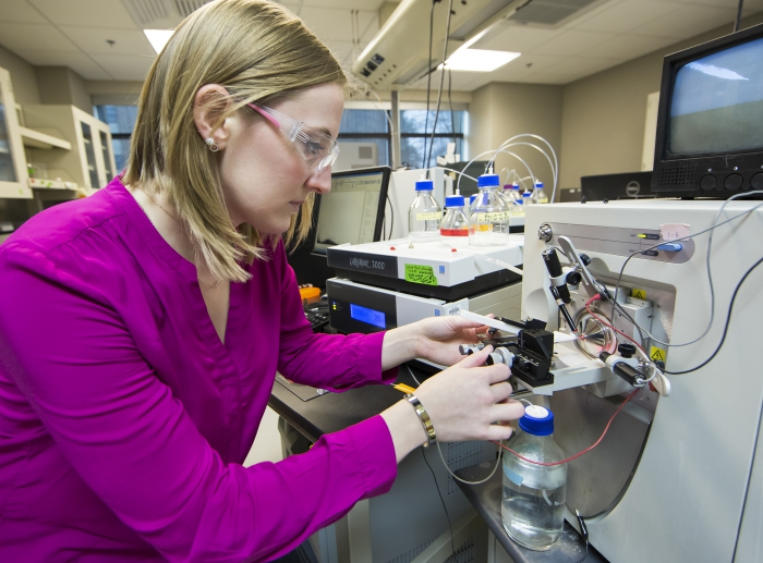 Mallory Ladd uses liquid chromatography and high-resolution mass spectrometry to characterize the molecular composition of nitrogen in soil samples from a polygonal tundra near Barrow, Alaska. Photo courtesy of Joy Anderson, ORNL.