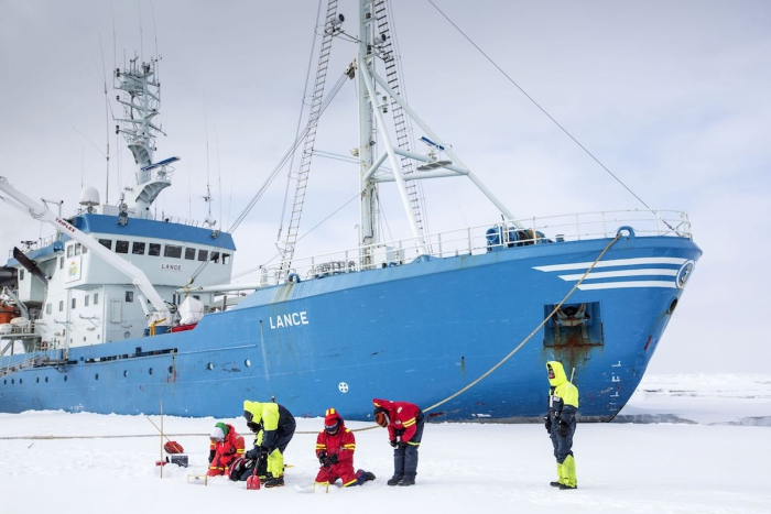 IASC facilitates international and interdisciplinary connections for Arctic science. Students pictured above are  moored to an ice-flow next to the Norwegian Polar Institute's RV Lance. Photo courtesy of Lawrence Hislop, Norwegian Polar Institute.