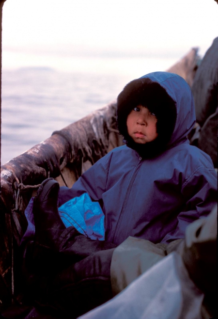 St. Lawrence Island child traveling by skin boat. Photo courtesy of Brendan Kelly.