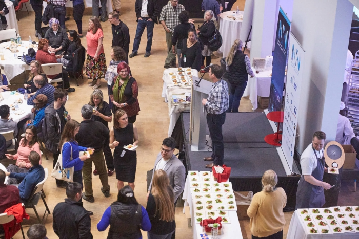 Participants at the 2018 Anchorage Arctic Research Day and North by North Festival network during the evening reception in the Anchorage Museum.  Photo courtesy of Institute of the North.