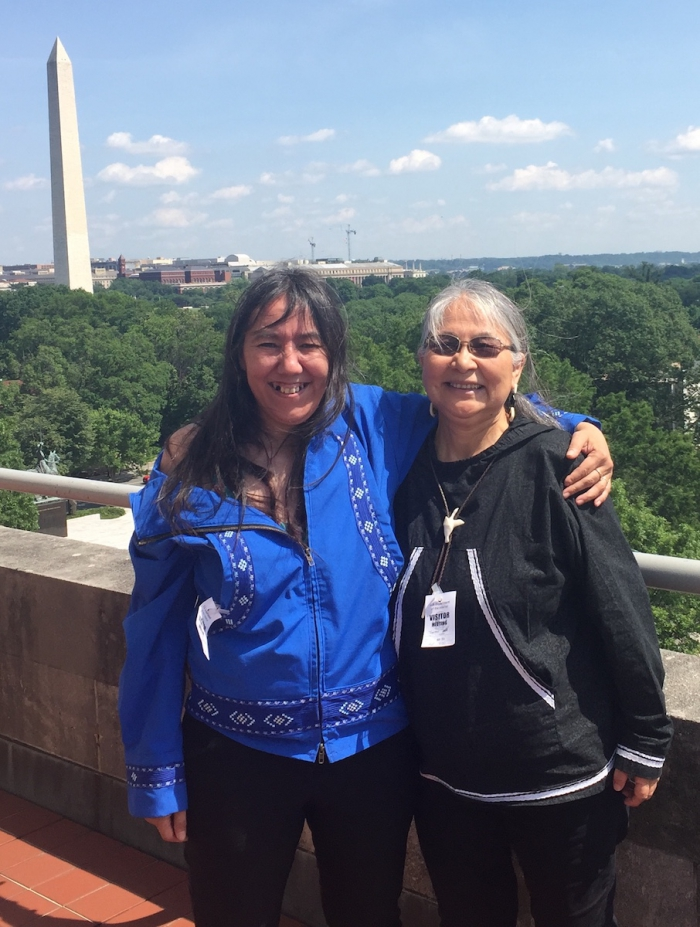 Scholarsm Rosemary Ahtuanguarak (left) and Theresa Arevgaq John (right) at Secretary of Interior's private balcony. Photo courtesy of Robert Rich.