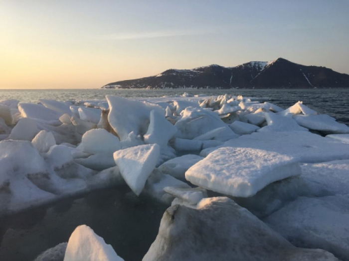 Figure 21: Remnants of sea ice off Cape Mountain in Bering Strait, 27 May 2016 (Photo: Amos Oxereok).