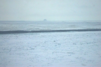 11 April 2012 - View of shorefast ice, narrow lead, and drift ice off Wales. Pho