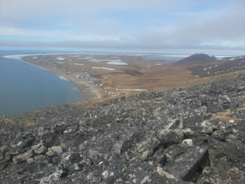 13 June - A small strip of landfast ice north of Wales. Image taken from atop Cape Mountain looking north.