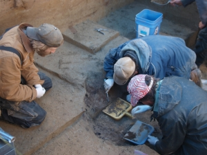 Excavating the burial pit