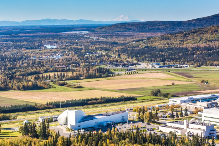 Denali is seen on the horizon behind the University of Alaska Museum of the North on the University of Alaska (UAF) campus in an aerial photograph taken about 11:20am on 10 September 2016. UAF Photo by Todd Paris.