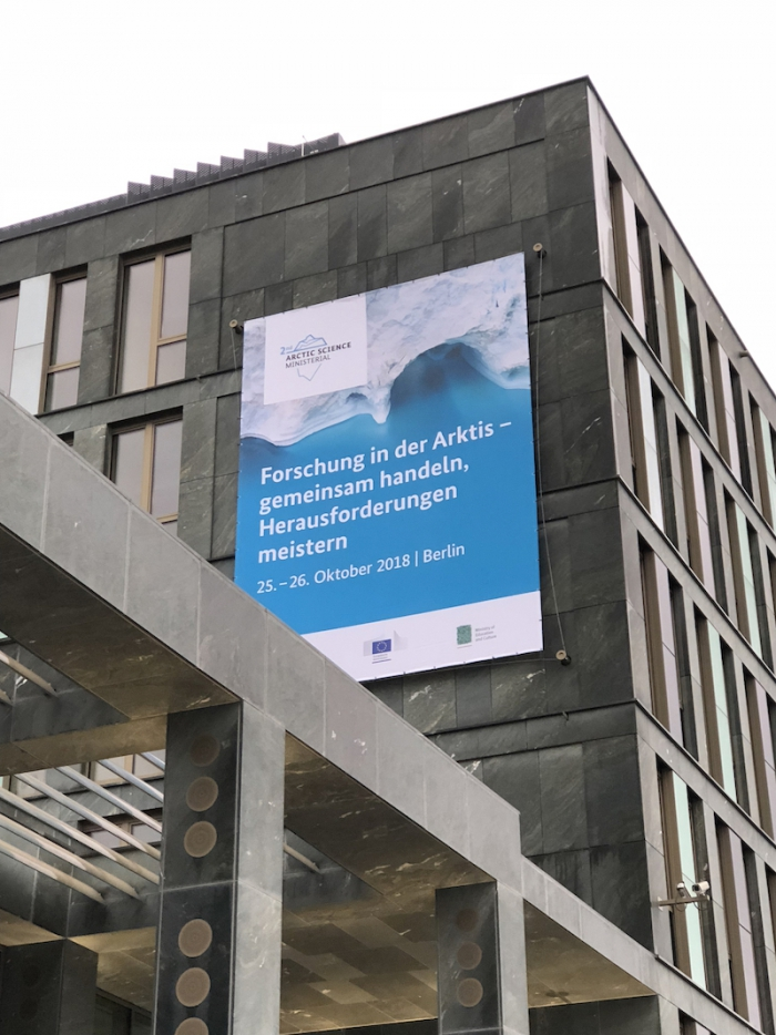 """Figure 3. The venue for the ASM-2 Arctic Science Forum was the Federal Ministry of Education and Research on the north bank of the River Spree in Berlin. In English, the banner reads """"Cooperation in Arctic Science – Challenges and Joint Actions"""". Photo courtesy of Martin Jeffries."""