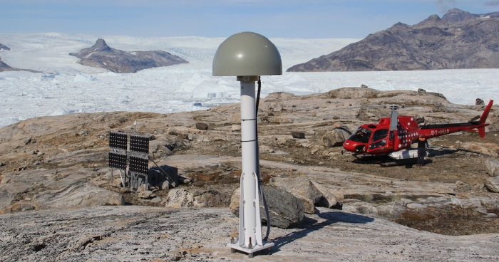 Figure 2. GNET Site TREO. The GNSS antenna sits under a radome on a steel mast bolted to bedrock.  Access is by Air Greenland helicopter. Photo courtesy of Thomas Nylen.