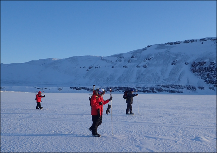 Figure 1. USNA midshipmen conducting snow depth surveys over fast-ice on North Star Bay using GPS-enabled MagnaProbes. Picture taken by Dr. Joseph Smith.