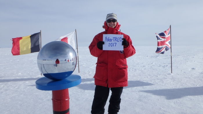 Kate Miller supports PolarTREC at the Ceremonial South Pole in Antarctica. Photo by Samuel Flis, courtesy of Kate Miller (PolarTREC 2016), courtesy of ARCUS.