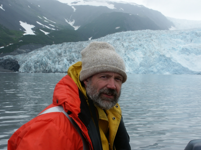 Aron Crowell at Aialik Glacier during archaeological fieldwork in Kenai Fjords National Park. Photo courtesy of Mark Luttrell.