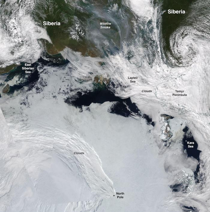 Figure 9. This true-color composite of sea ice conditions along the Siberian coast, from Moderate Resolution Imaging Spectroradiometer (MODIS) sensor on the NASA Terra satellite on 12 July 2020. Also visible is the smoke from wildfires surging in Siberia. Credit: NASA Worldview.