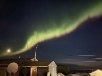 Northern lights over the community of Shishmaref in spring 2021. Image courtesy of Kaare Sikuaq Erickson.