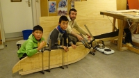 Figure 1. Bending the wood (from the left: Gr 7 pupils Ajaattoq Kristiansen, Sivert Kristiansen and teacher Max Audibert). Photo courtesy of Kamilla Oliver.