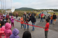 Photo 1. Ribbon cutting over newly paved road in Elim, 2019. Photo courtesy of Davis Hovey.