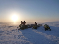 The team stopped for a short break on a calm, cold evening in the Arctic on their final stretch run of a 1,000 mile, three-week round trip traverse between Toolik Field Station and the Teshekpuk Lake Observatory in March 2012 while conducting fieldwork for the NSF-CALON project. Photo courtesy of Guido Grosse.