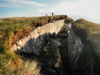 Coastal erosion reveals the extent of ice-rich permafrost underlying active layer on the Arctic Coastal Plain in the Teshekpuk Lake Special Area of the National Petroleum Reserve - Alaska. Photo courtesy of Brandt Meixell, USGS.