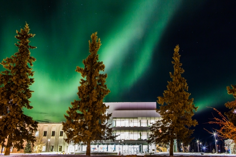 The aurora creates a dynamic display behind the University of Alaska (UAF) Murie Building on upper campus. UAF photo by JR Ancheta.