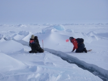 Cathy Geiger and Nick Hughes set up a station to measure the width of the lead. At the SEDNA/APLIS Ice Camp north of Prudhoe Bay, Alaska.