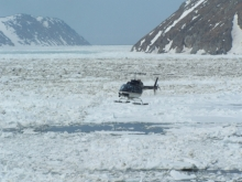 Helicopter comes in to land on the USCG Healy icebreaker after visiting Little Diomede Island, U.S.