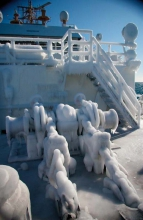 Figure 1. Collisions of vessels with waves produces spray that freezes on topsides of vessels, which reduces stability and complicates vessel operation. Larger waves in the Arctic Ocean, due to reduced sea ice, increases the risk of vessel icing. Photo courtesy of Mariners Weather Log Vol. 59, No. 3, December 2015.