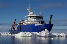 The research vessel Sikuliaqnavigates through Arctic ice in summer 2016. The ship, which is owned by the National Science Foundation and operated by the University of Alaska Fairbanks, has joined the Arctic Research Icebreaker Consortium. Photo courtesy of Mark Teckenbrock.