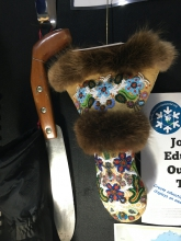 Figure 1. Snow has been central to Northern cultures for millennia, as evidenced by artifacts related to working with snow and surviving in winter. This traditional snow knife (handle is new) comes from Baker Lake, Nunavut, and the beaded mittens (courtesy of Museum of the North) come from around 1930 and are Gwich'in. Photo courtesy of M. Sturm.