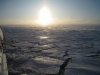Sun bounces off of the sea ice on a clear sunny day in the Arctic. Aboard the USCGC Polar Sea icebreaker in the Beaufort Sea.