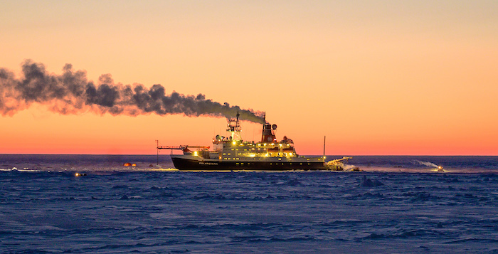 Figure 2. R/V Polarstern and research sites in the high Arctic twilight during the second leg of MOSAiC. Photo by Ivo Beck, used with permission.