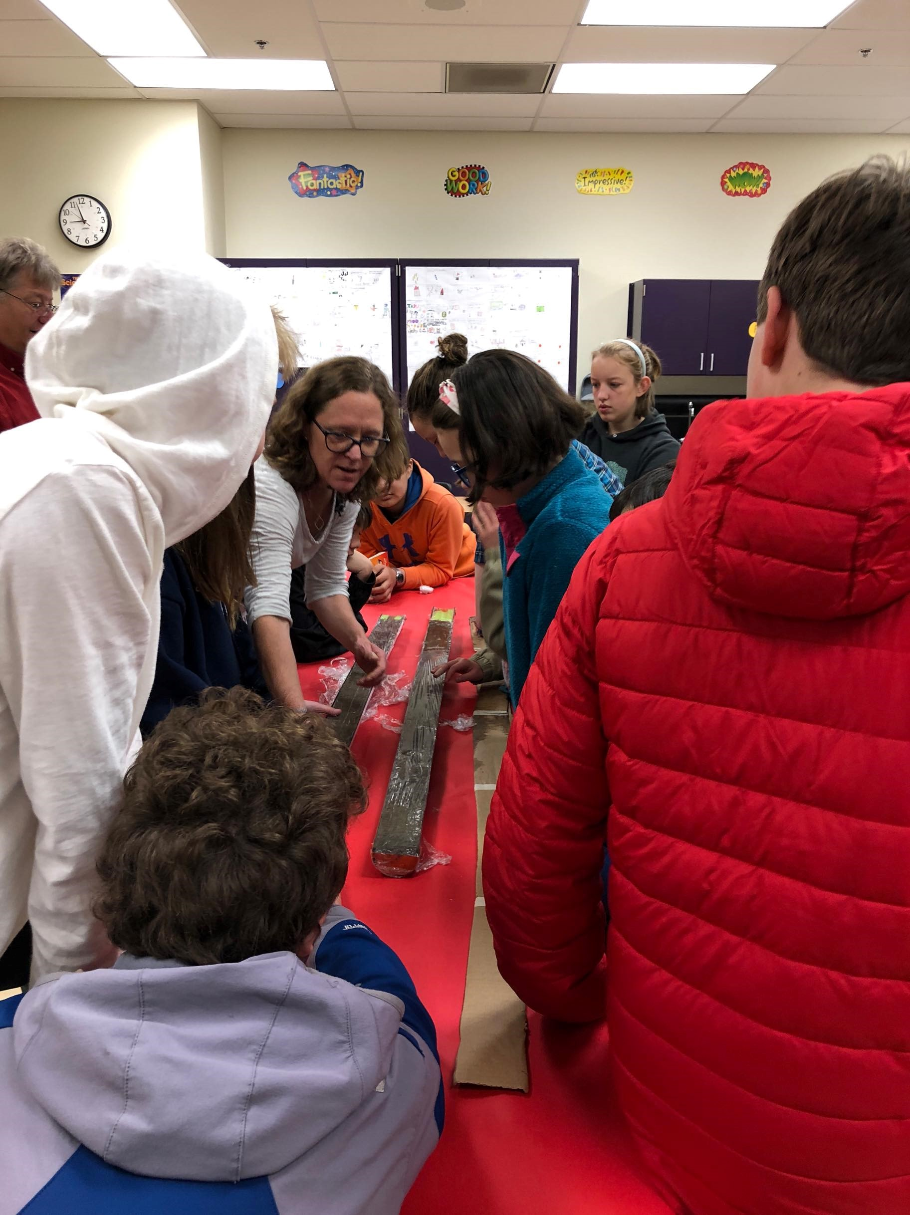 Scientist in Residency Fellow, Dr. Rachel Lauer, shows 7th grade students in Sitka, Alaska how she works with submarine cores. Photo courtesy of Kristina Tirman.