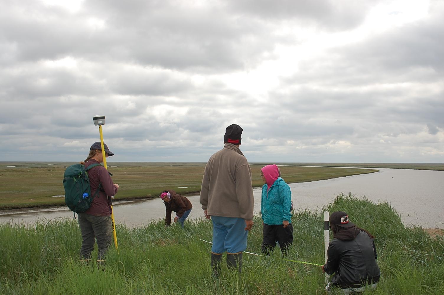Figure 3. Installing erosion monitoring in Chevak, Alaska in June 2017. Photo courtesy of Denise Pollock.