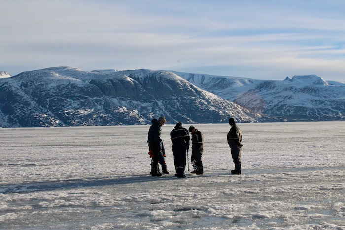 Figure 4. Measuring sea ice thickness with an ice drill. Photo courtesy of Sarah Cooley.