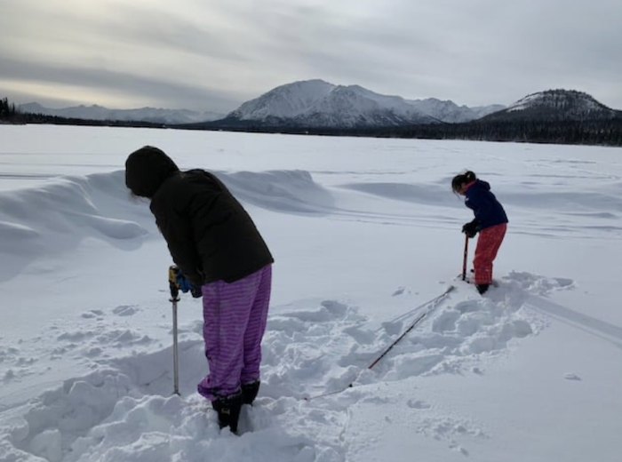 Figure 3a. Students from Copper Valley make monthly measurements of snow and ice thickness on lakes and rivers and observe the timing of freeze-up and break-up. Photo courtesy of Mark Proch.