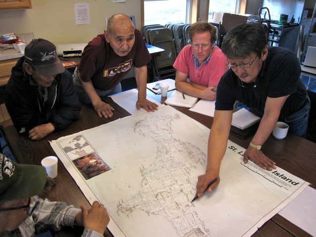 George Noongwook (far right) and Henry Huntington (second from right) conducting hunter interviews in Savoonga as part of their research for the dataset Savoonga Field Report for the Local and Traditional Knowledge component of the Bering Sea Integrated Ecosystem Research Program. Photo courtesy of Tom Van Pelt.